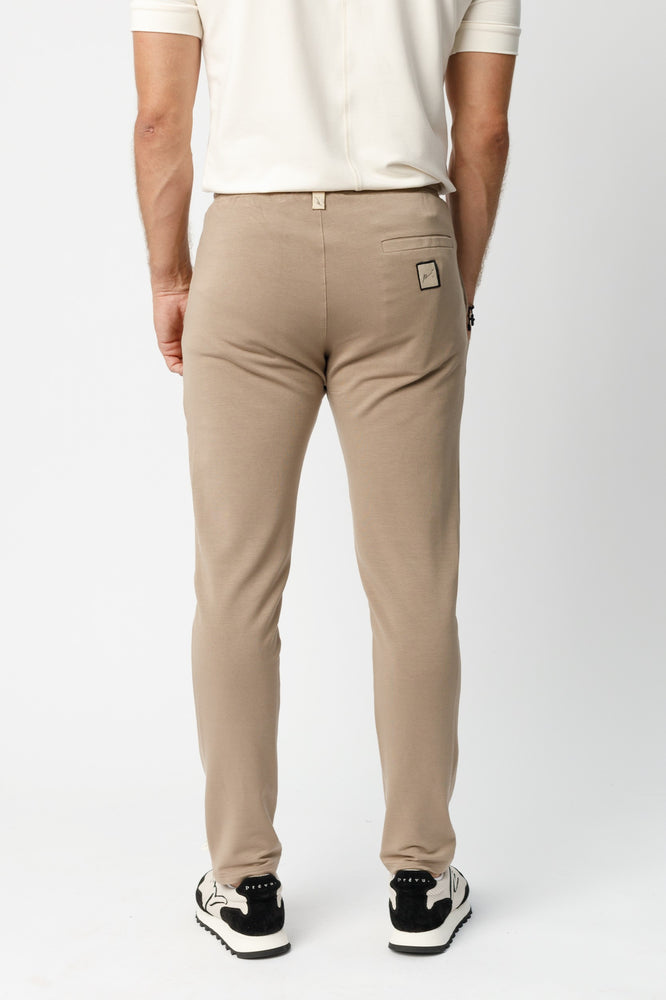 Load image into Gallery viewer, Beige Calvia Slim Fit Trousers - P r é v u . S t u d i o .