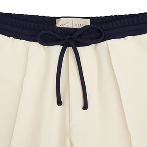 Cream Queens Pleated Shorts