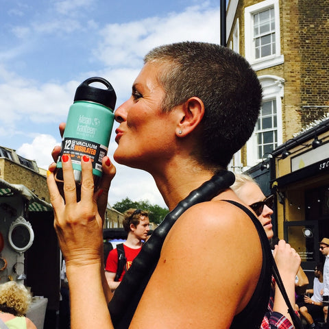 Woman holding Klean Kanteen flask in London market