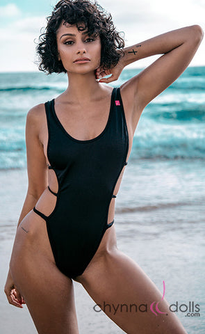 Susan: Open Side One Piece with Strap Detail in Black- $89.99