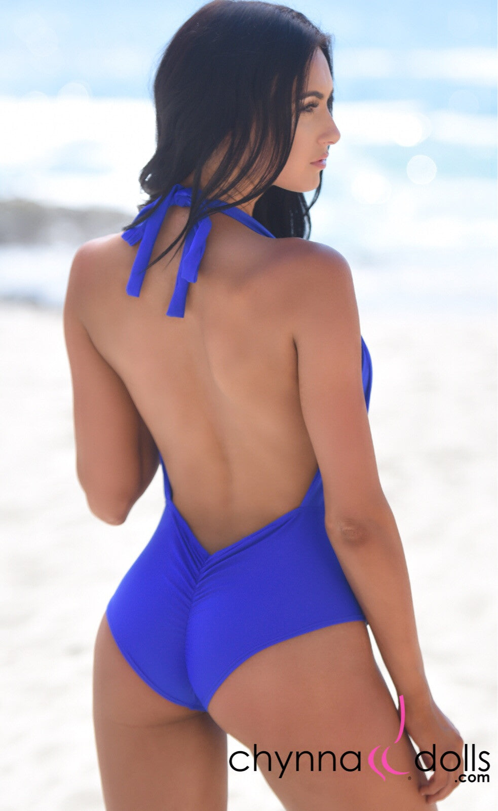 Selma: Deep plunge one piece w/ gold brooch in Royal Blue