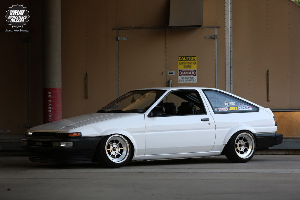 AE86 Corolla - motor: - hks intake w/ blue 45 degree coupler - hks timing belt - trd header w/ heat shield bracket grinded off, egr hole closed and smoothened, and header rapped with titanum header rap - blue ngk spark plug wires - new ngk platinum plugs - custom exhaust (sounds deep, not ricey) - hks style smoke oil cap - aluminum twin core radiator w/ flush fan - battery relocation - valve cover letters shaved off, and painted fire proof flat black - intake letters shaved - wire tucked like crazy - fuel line tuck - brake line tuck - freshly rebuilt motor - pulleys sand blasted and painted gold