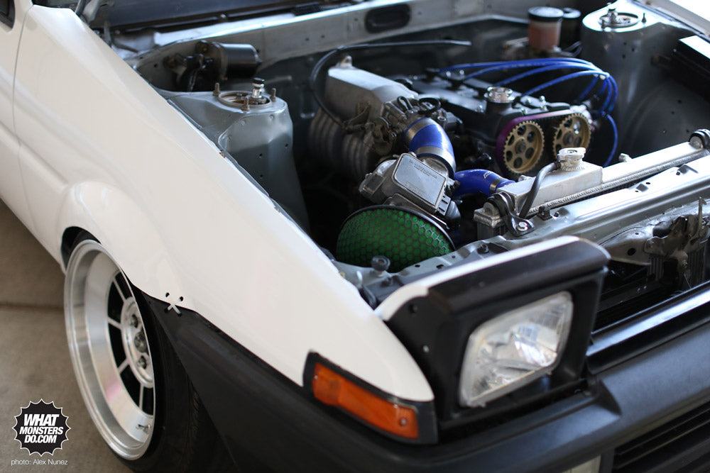 AE86 Corolla Trueno motor: - hks intake w/ blue 45 degree coupler - hks timing belt - trd header w/ heat shield bracket grinded off, egr hole closed and smoothened, and header rapped with titanum header rap - blue ngk spark plug wires - new ngk platinum plugs - custom exhaust (sounds deep, not ricey) - hks style smoke oil cap - aluminum twin core radiator w/ flush fan - battery relocation - valve cover letters shaved off, and painted fire proof flat black - intake letters shaved - wire tucked like crazy - fuel line tuck - brake line tuck - freshly rebuilt motor - pulleys sand blasted and painted gold