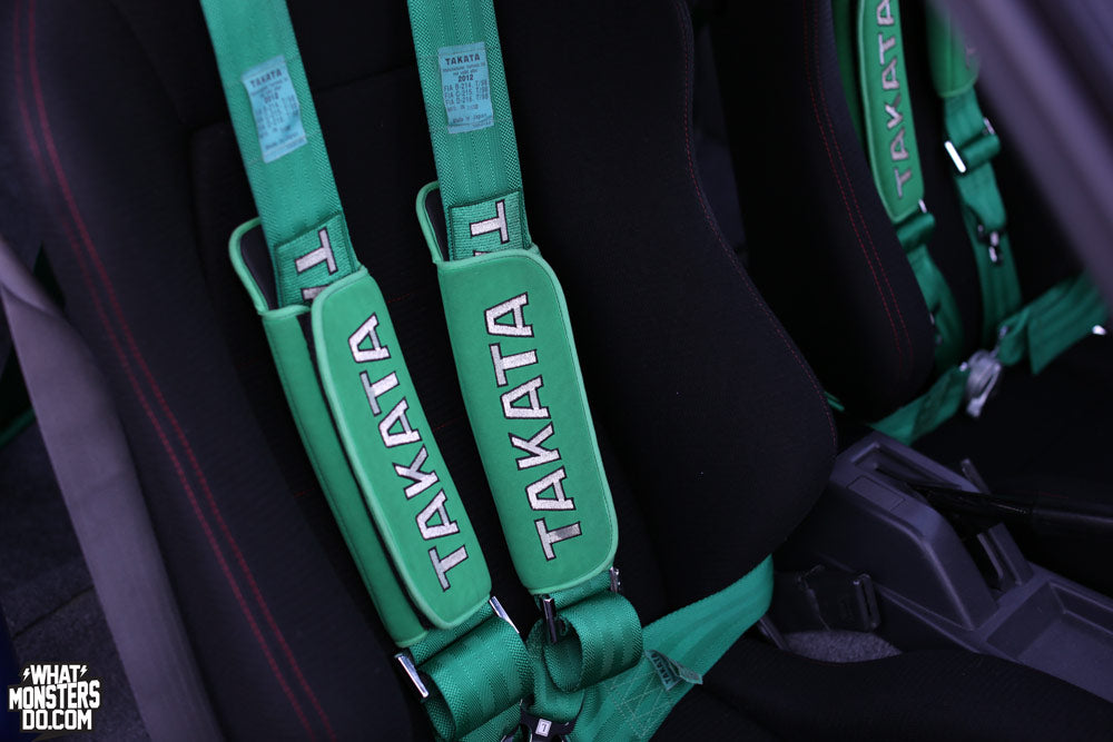 takata belts seat belts at what monsters do booth Formula Drift Long Beach AE86