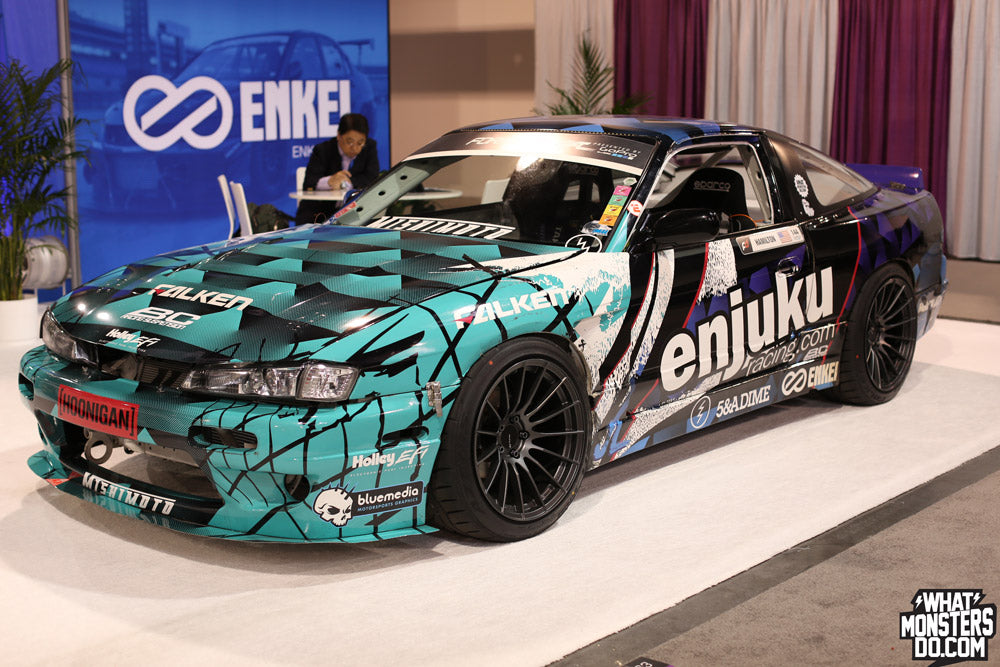 SEMA 2013 Coverage High Res Photos of Cars and Car parts. Nate Hamilton s13 at the Enkei Wheels booth RS05RR