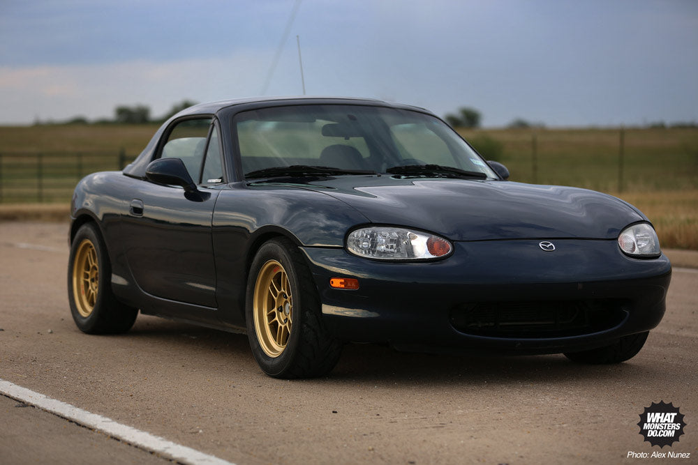 1999 Mazda Miata on 14x7 +19 Enkei RPF1 with 205/55r14 14 inch Toyo R888 Tires being mounted by Texas Track Works in Fort Worth Texas