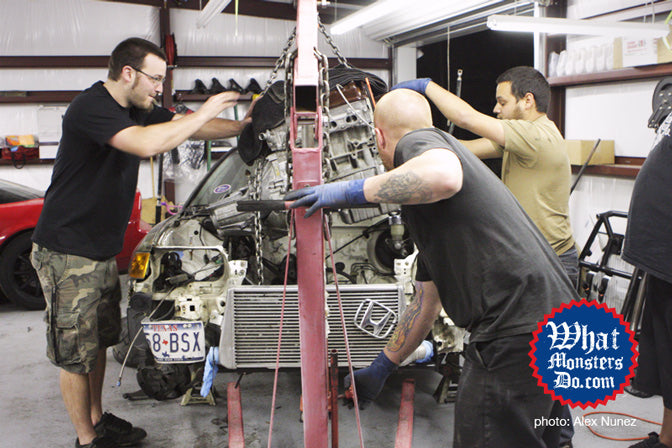 honda civic motor and transmission being installed for texas mile honda civic crx on motor lift