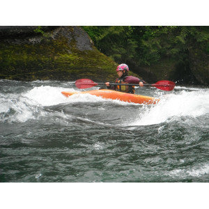 whitewater kayaking playing on standing wave