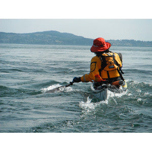 paddling kayak on edge to cross tidal current