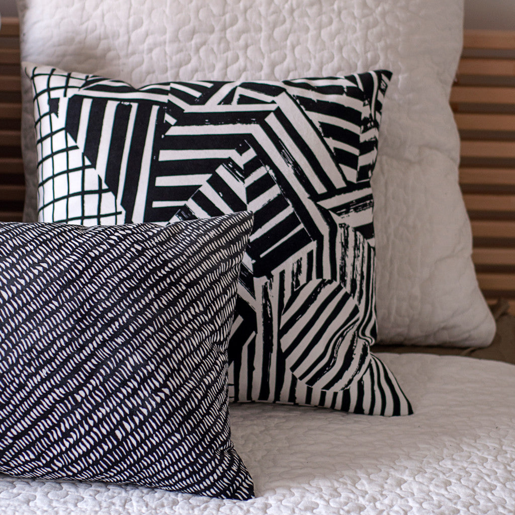 Black and white pillows from the LEXICON collection by Antipod Workshop