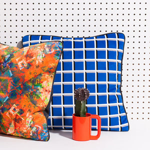Printed pillow: orange/blue layered photgraphic design