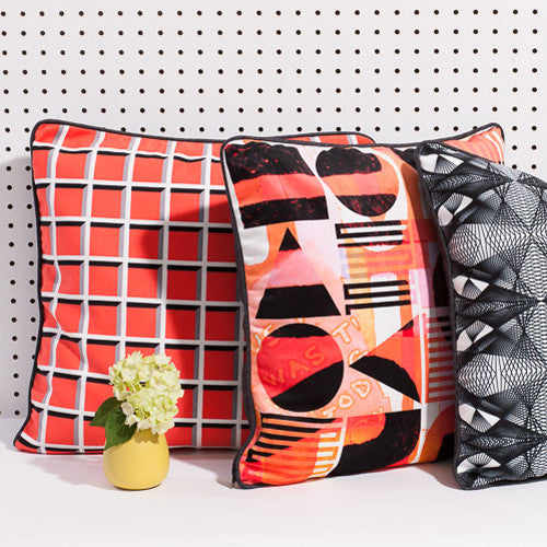 Printed pillow: orange grid design