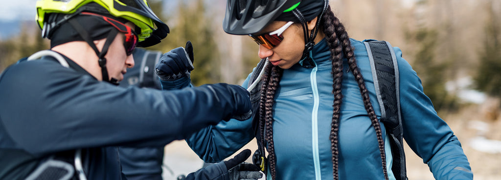 Woman using a protective style to mountain bike in cold weather