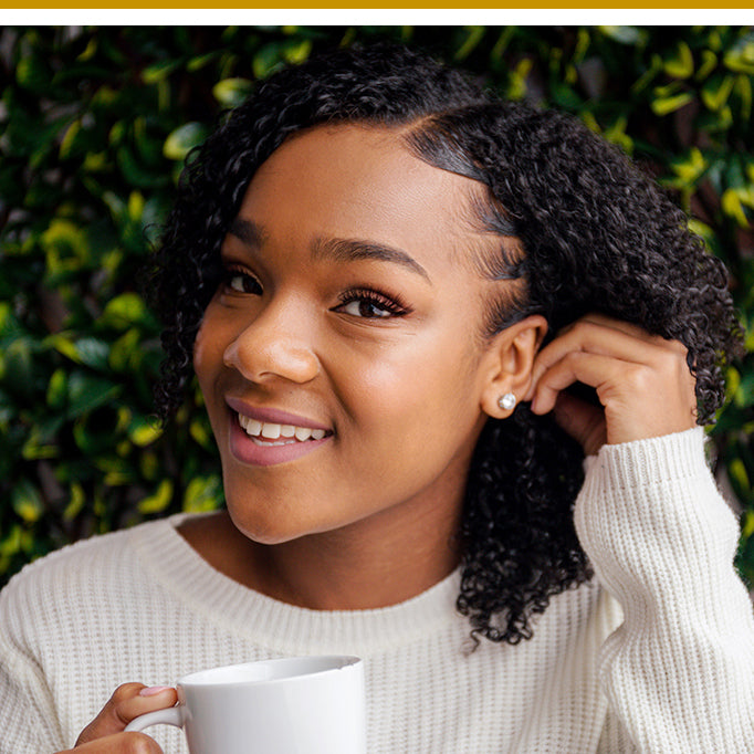 Woman with naturally curly hair with styled edges