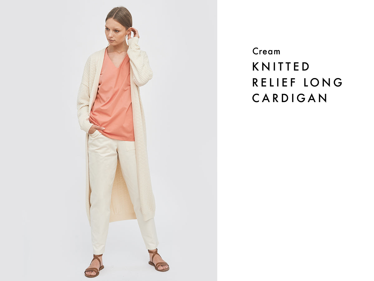 Sustainable layered summer look with organic cotton cream cardigan