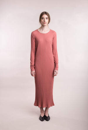 The model wears peach, sustainable organic cotton, wide-rib long dress, front view.