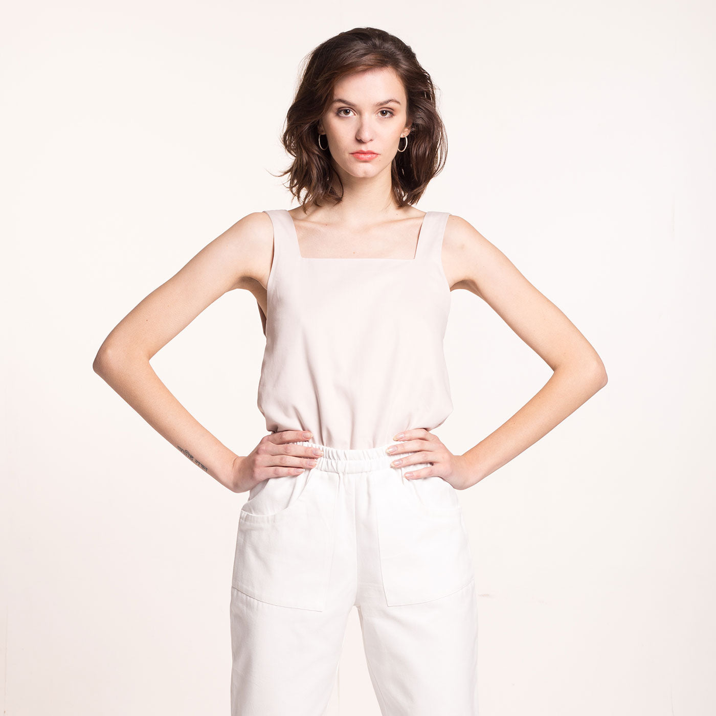 The model wears a rose-beige, sustainable, organic cotton, wide straps top, front view.