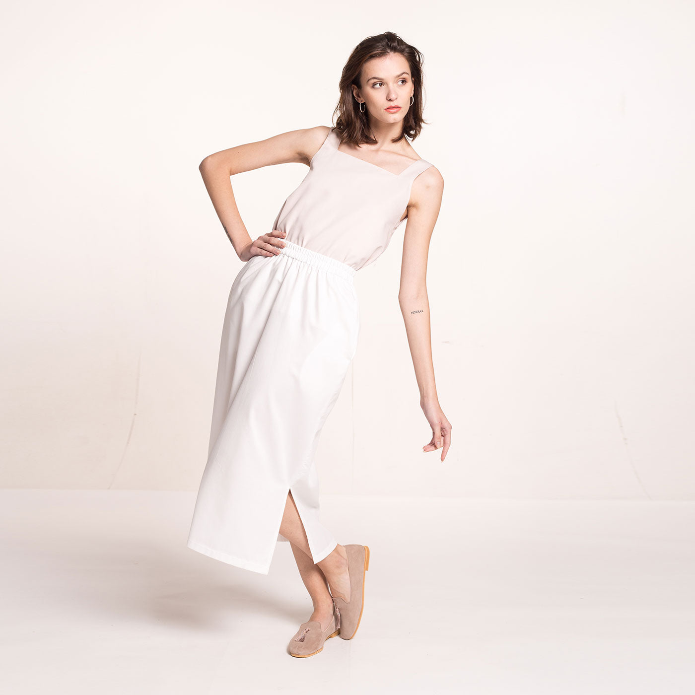 The model wears a rose-beige, sustainable, organic cotton, wide straps top.