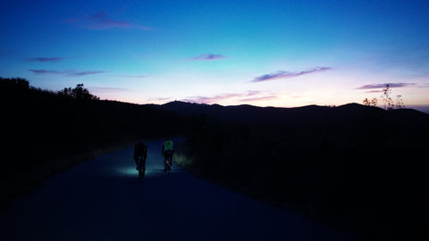 Two cyclists riding into the sunrise in Portugal