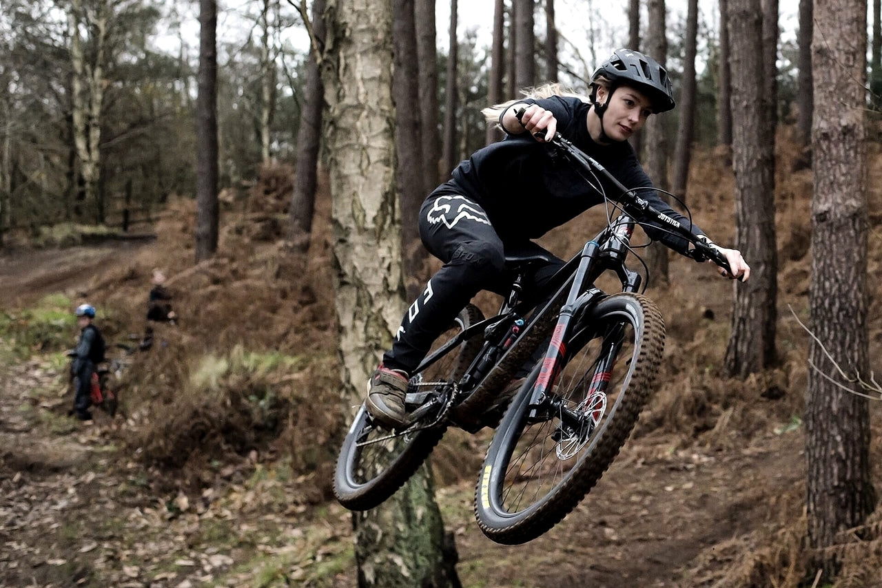 Becci Skelton shredding in the woods