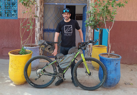 Sofiane stood with his bike proudly wearing a Hunt tshirt
