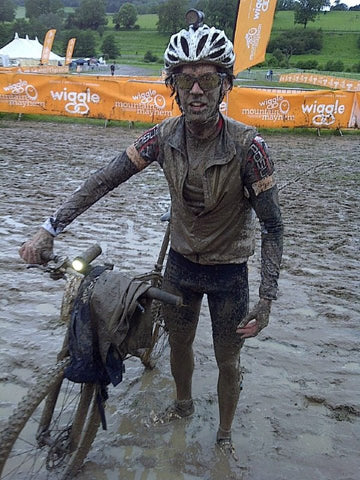 Rich Rothwell and his bike covered in mud