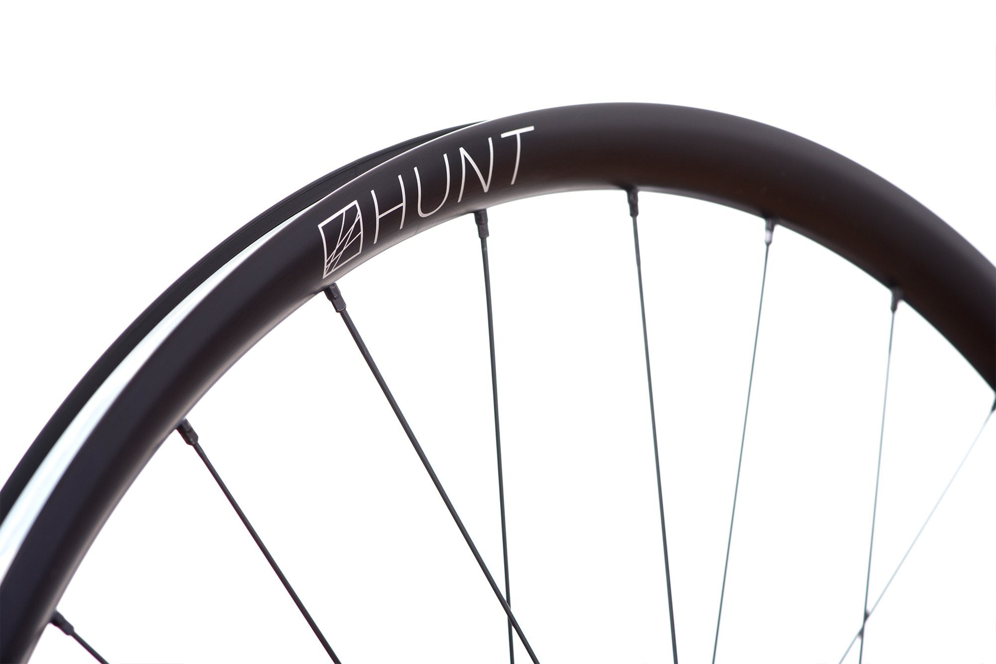 <h1>Rims</h1><i>A strong and lightweight 6066-T6 heat-treated rim features an asymmetric shape which is inverted from front to rear to provide balanced higher spoke tensions meaning your spokes stay tight for the long term. The rim profile is disc specific which allows higher-strength to weight as no reinforcement is required for a braking surface. The extra wide rim at 29mm (25mm internal) which creates a great tyre profile with wider 28-54mm tyres, giving excellent grip and lower rolling resistance.</i>