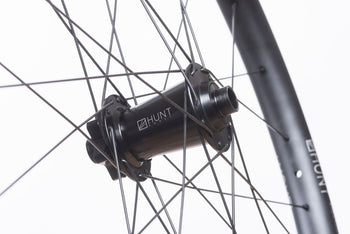 <h1>Front Hub</h1><i>We have gone all out on the front hub and beefed it up over our XCWide and TrailWide wheelsets. Featuring an oversized shell to accommodate larger and extremely durable bearings and 7075-T6 series alloy axles to increase stiffness. These hubs have been selected based on their ability to perform on the most aggressive trails.</i>