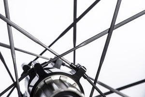 UD Carbon SpokesIncredibly strong (achieving over 450kgf per spoke) TaperLock UD carbon spokes offering 30% increase in stiffness against steel ones. Only 2.7g per spoke. Due to the TaperLock technology, these spokes can be trued easily using a spoke key from within the rim bed.