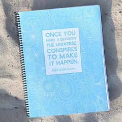 large notebook with pagination and inspirational quote