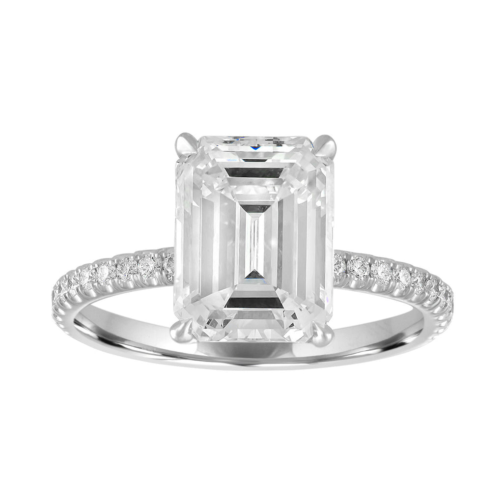 emerald cut engagement ring with pave band