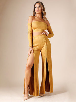 Lexa, pants with thigh high slits and gold button - Dimesi Boutique