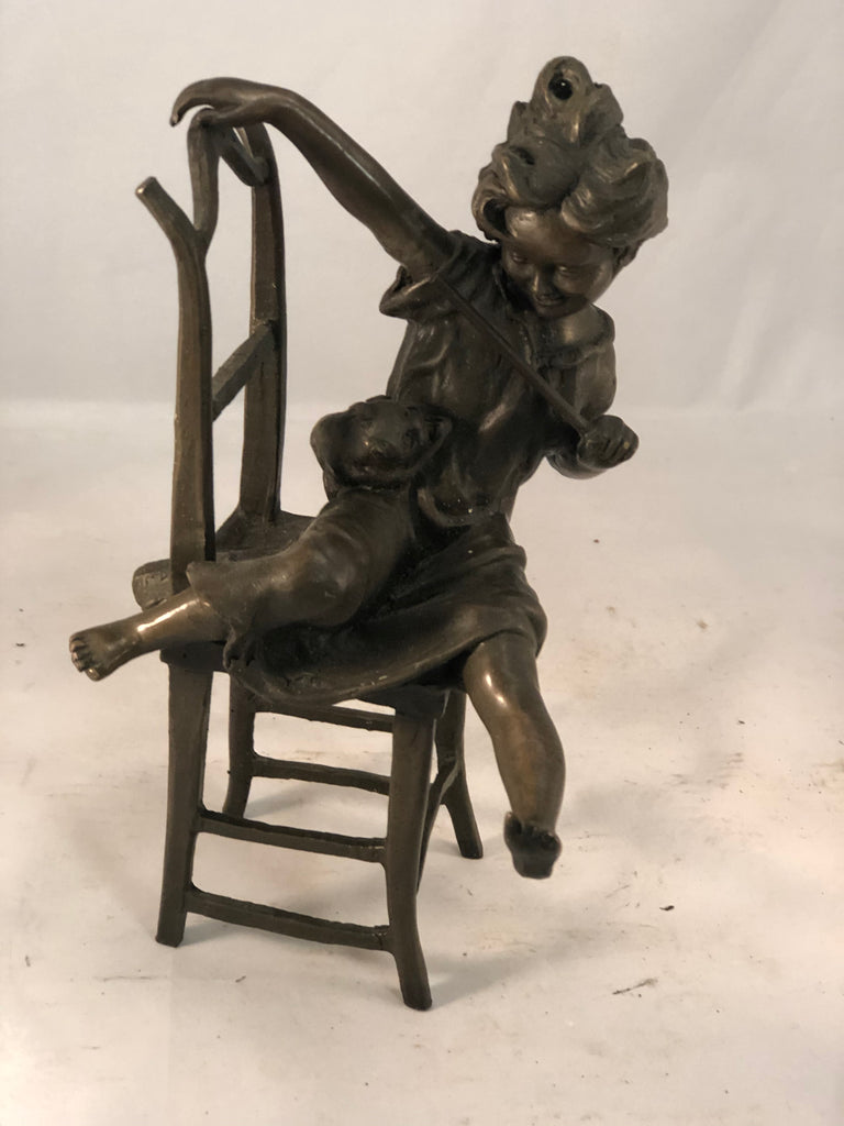 Bronze of girl with cat