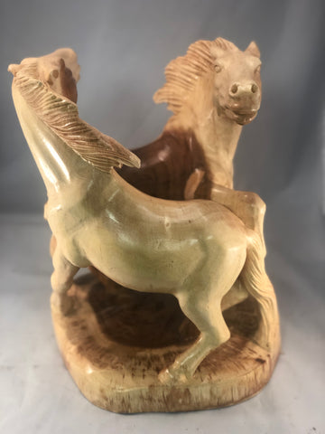 Handcarved circling horses