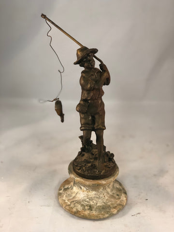 Bronze on marble of little boy fishing