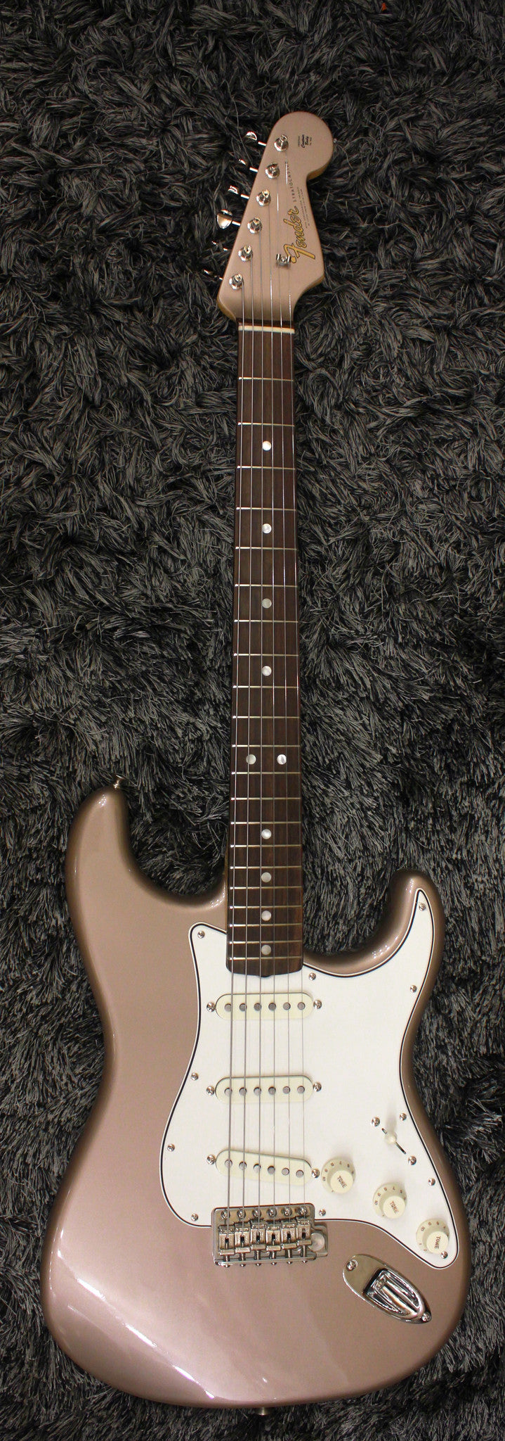 Fender® American Vintage '65 Stratocaster® in Shoreline Gold with Matching Headstock