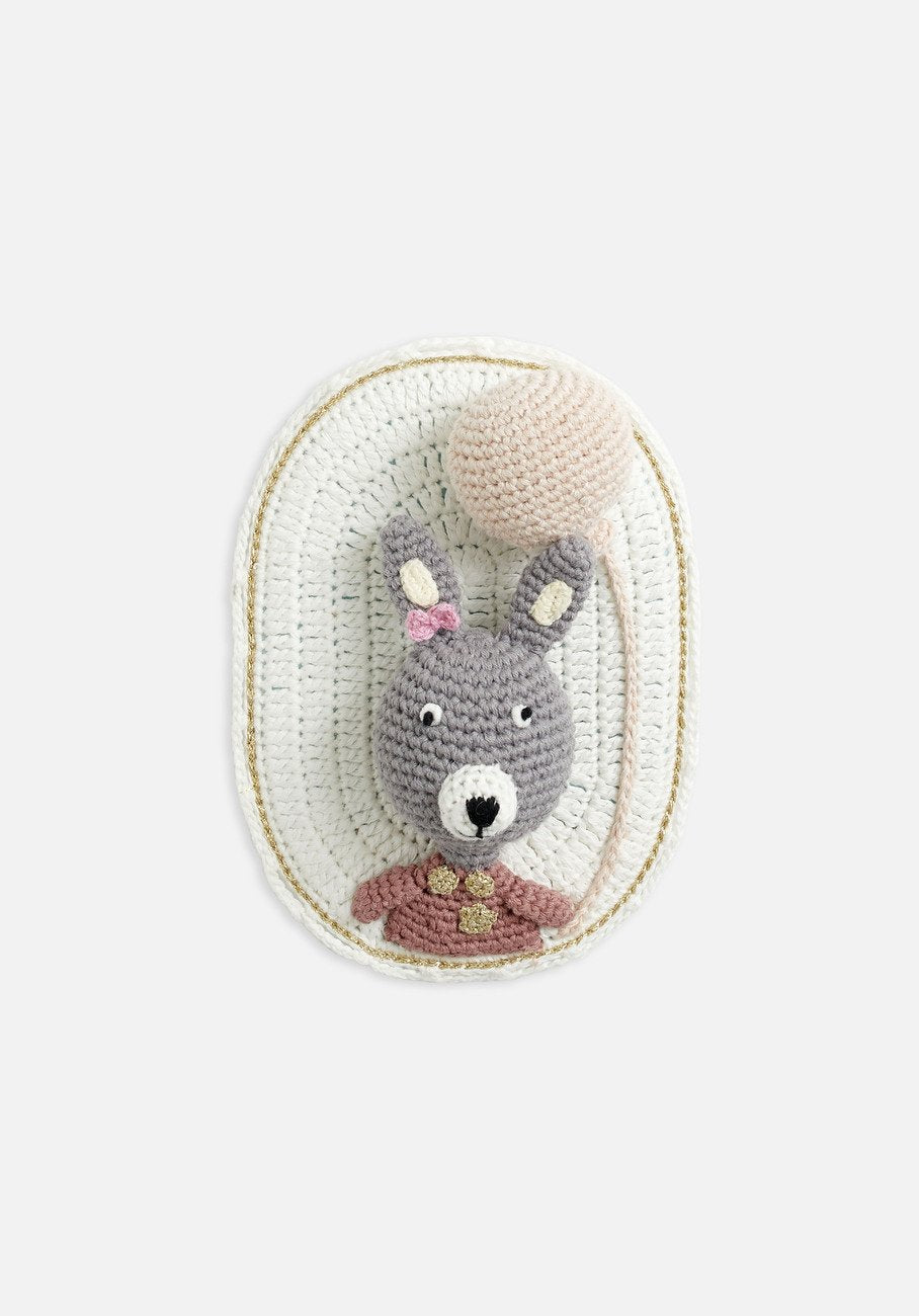 wall hanging bunny on white backing and balloon