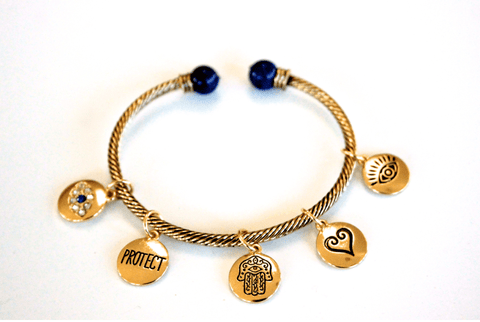 Protective bracelet with Hamsa and evil eye charms
