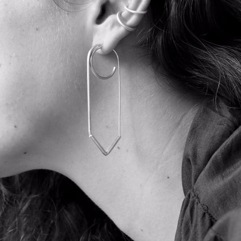 Elegant rectangle V shaped earring with a three-quarters circle that makes the illusion of two earrings in the same hole.
