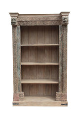 [[Pastel beige book shelf with old decorative door frame///Bibliothèque beige pastel avec une ancienne porte décorative]]