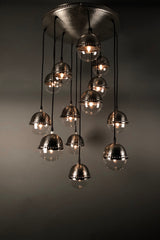 [[Hand forged metal and glass chandelier with 13 small globes///Lustre en métal et verre forgé à la main avec 13 petits globes]]