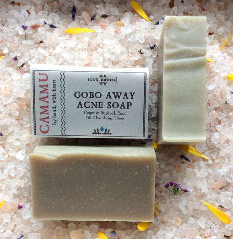 Camamu's GoBo Away Acne Soap is a complexion soap useful against acne-prone skin. Infused with organic burdock root and swirled with skin-conditioning clays, this soap is scented with anti-septic, skin-rebalancing essential oils.