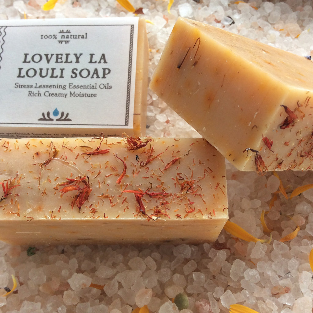 Camamu's Lovely la LouLi Soap combines a stress-reducing essential oil blend with richly moisturizing base oils to create a beauty of a soap.  Colored orange with culinary spices and safflower petals. Lovely!
