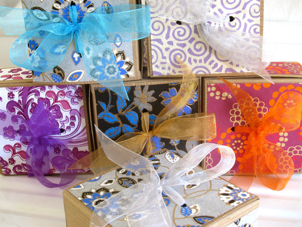 Camamu's lovely hand-papered kraft gift boxes containing three 4-oz bars of our all natural, handmade soap.