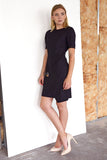 The Flap Front Dress is a Black Sheath dress with elbow length sleeves and a front wrap around flap. Made in 100% wool. Fully lined.