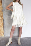 The fringe skirt is we think fringe should be done! Two layers of faux leather hand cut fringe is woven on to the waist band.