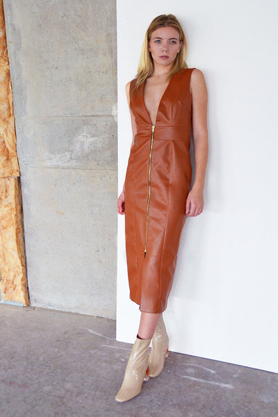 The Marin faux leather dress is made from a supple faux leather and has a plunging v neck with an exposed zipper in the front.