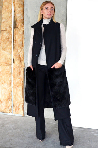The Rococo Vest Coat is a long double breasted vest coat and has deep patch pockets cut from faux fur. The asymmetrical collar keeps the neckline fresh.