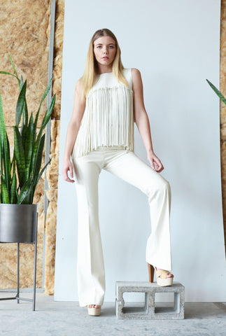 The fringe top is how we think fringe should be done! Faux leather hand cut fringe is woven on to the top yoke.