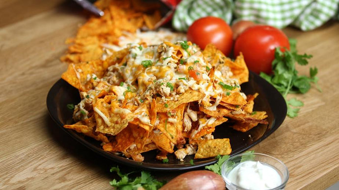Shredded Chicken Plantain Nachos with Avocado Lime Sauce & Green Onion